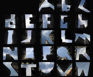 26 Letters Captured Between Buildings Outline