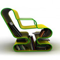 A Curved Lounge Chair With Built-In Book Storage