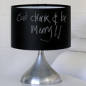 A lamp whose shade doubles as a chalkboard