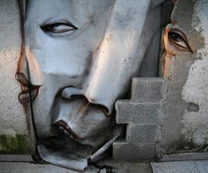 Artist Paints Distorted Faces Throughout Streets of Brazil