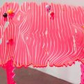 Artistically cool pink table for bold interiors