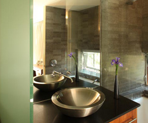 Bathroom, metal vessel sink, glass room divider, by Bill Fry