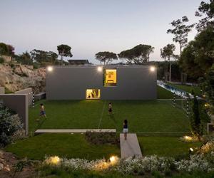 Box-Like Home with Mini-Soccer Field in the Backyard