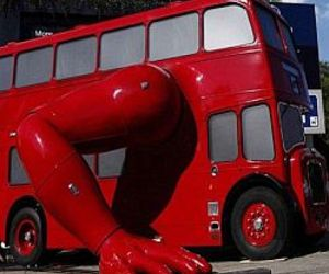 Bus converted into mechanical structure that does push-ups
