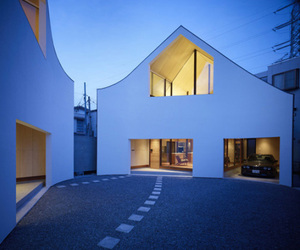 Curved Facade of a House Split in Two