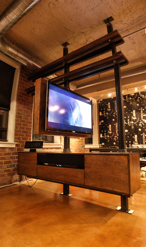 Dbd studio cantilevered rotating media cabinet for Armoire television salon