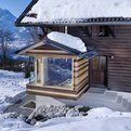 Extension of a Log Cabin in the Swiss Alps