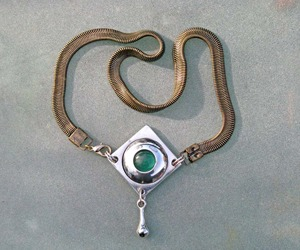 Eye with a Tear Pendant