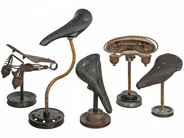 Vintage Bicycle Seats : Group of five vintage bicycle seats mounted on rustic stands