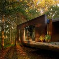 House in the woods by Rosales and Crecente