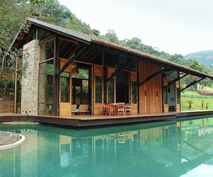 Itaipava House Bordering And Encompassing Water
