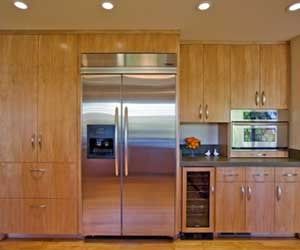 Kitchen with European style custom kitchen cabinetry