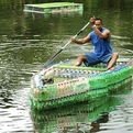 Man in Fiji makes boat from littered bottles