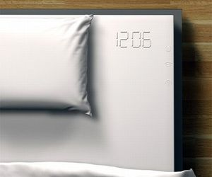 Melted Alarm clock embedded in the bed