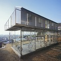 Metal and Glass House by Tato Architects