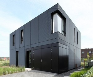 Minimalist Home With Expanding Metal Exterior