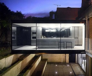 Minimalist House Built Beneath Another by Paul Archer