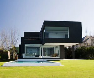 Modern black house on the lake