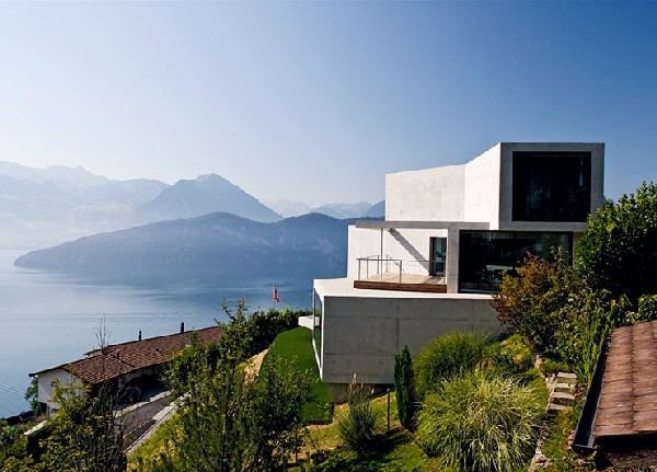 swiss home design.  Modern Concrete Home Overlooking the Swiss Alps