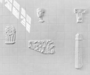 Original White Tiles Exhibiting Archaeological Fragments