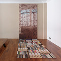 Remodled Apartment With In-the-Floor Bookcase