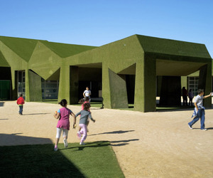 School Covered in Grass by Estudio Huma
