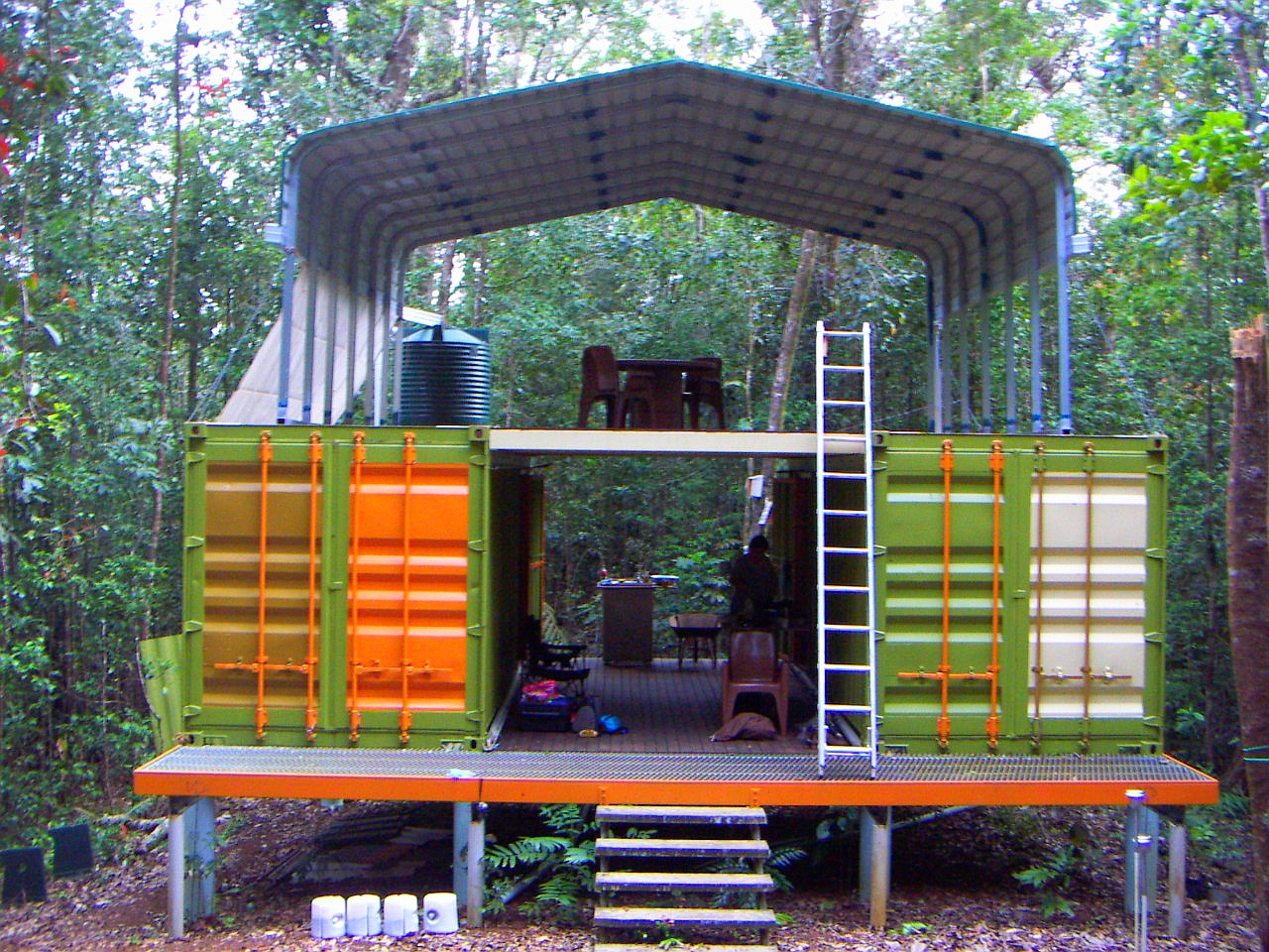 shipping container cottage in rainforest -