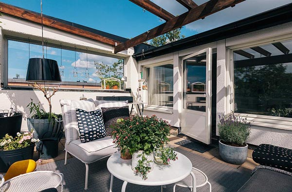 Small Swedish Apartment Featuring Cozy Rooftop Terrace