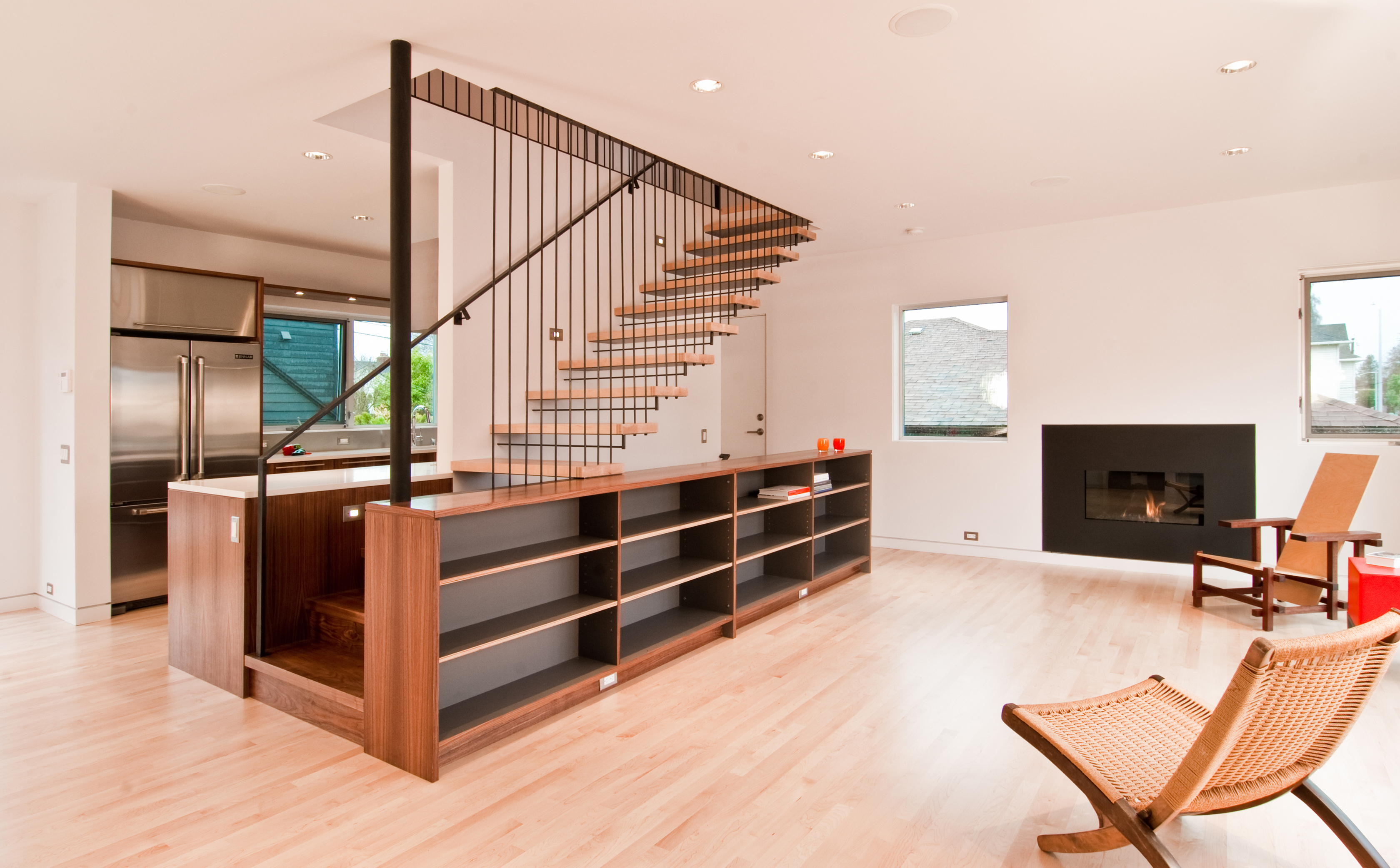 Steel wood stair by build llc for Living room designs with staircase
