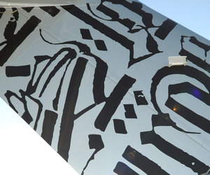 Street Artist RETNA paints a $60 million Jet