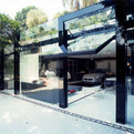 Striking Transparency of A Modern Live-In Garage
