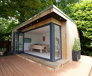 Luxury garden rooms by studioni for Luxury garden sheds
