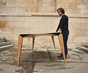 'Triomphe' plywood table by USIN-e and Jerhome