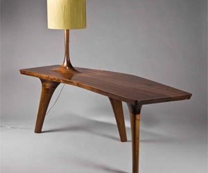 Unique Table with Three Legs and a Beautiful Lamp