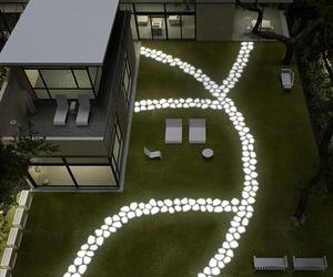 Walkover Lighting by Serralunga for a Dazzling Garden