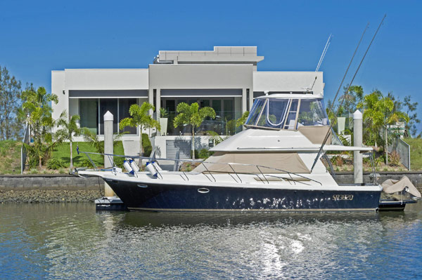 Waterfront modern home by blueprint design for Modern waterfront home plans