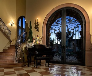 Wrought Iron Entry Door and Staircase Railing